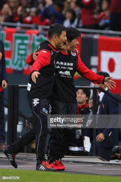Shuhei Yomoda of Consadole Sapporo celebrates his team's 32 victory with his team staff after the JLeague J1 match between Consadole Sapporo and...