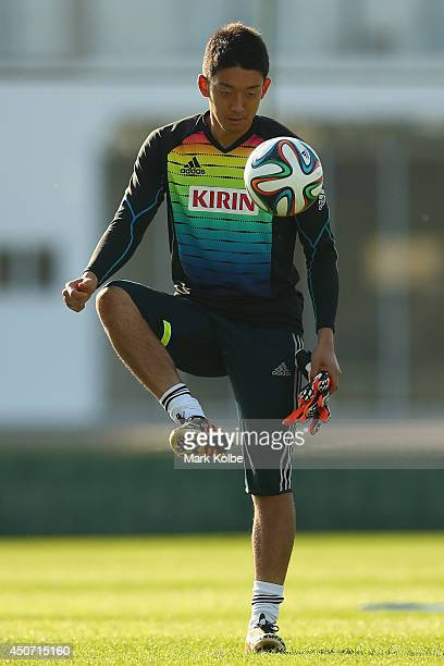 Shuichi Gonda juggles a ball during a Japan training session at the Japan national team base camp at the Spa Sport Resort on June 16 2014 in Itu Sao...