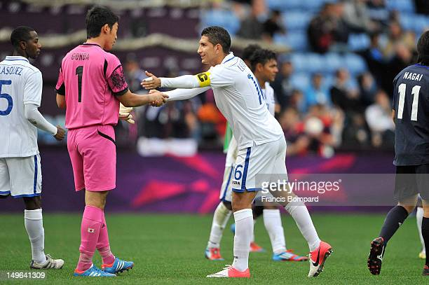 Shuichi Gonda of Japan and Jhonny Leveron of Honduras at the end of the match during the Men's Football first round Group D Match between Japan and...