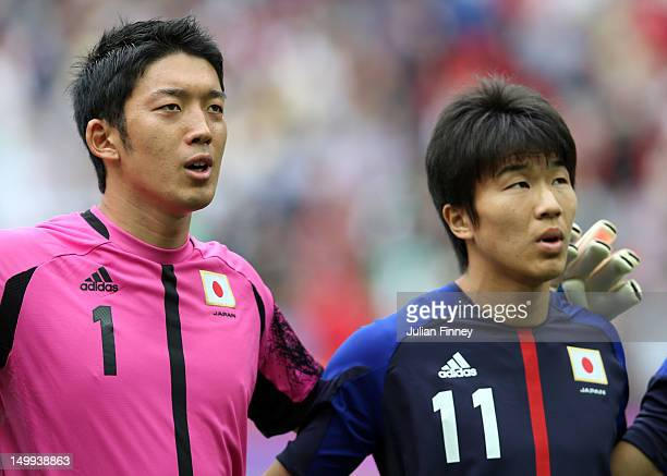Shuichi Gonda of Japan and Kensuke Nagai of Japan look on during the Men's Football Semi Final match between Mexico and Japan on Day 11 of the London...