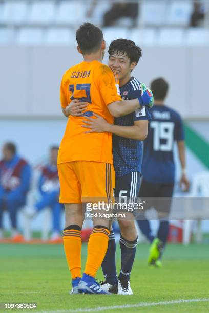 Shuichi Gonda of Japan and Wataru Endo of Japan celebrate following their sides victory in the AFC Asian Cup round of 16 match between Japan and...