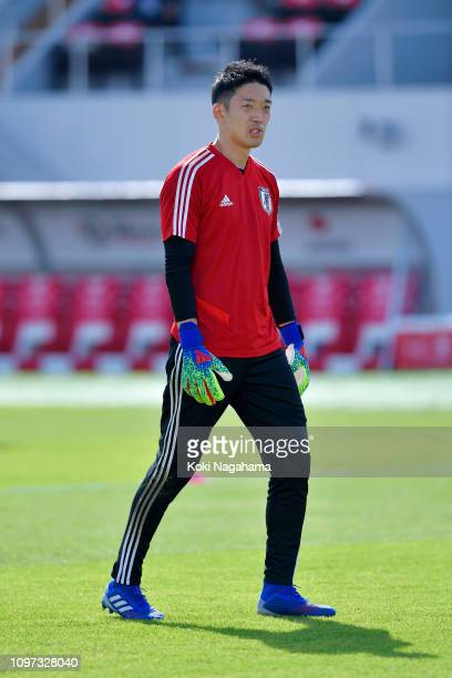 Shuichi Gonda of Japan looks on during his warm up prior to the AFC Asian Cup round of 16 match between Japan and Saudi Arabia at Sharjah Stadium on...