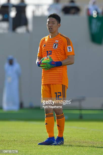Shuichi Gonda of Japan looks on during the AFC Asian Cup round of 16 match between Japan and Saudi Arabia at Sharjah Stadium on January 21 2019 in...
