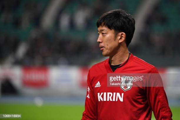 Shuichi Gonda of Japan warms up prior to during the international friendly match between Japan and Venezuela at Oita Bank Dome on November 16 2018 in...