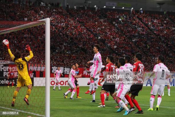 Shuichi Gonda of Sagan Tosu fails to make a save as Tomonobu Yokoyama of Consadole Sapporo scores his side's third goal during the JLeague J1 match...