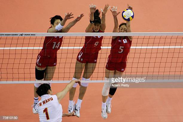 Shuka Oyama Sachiko Sugiyama and Miyuki Takahashi of Japan attempt to block Wang Yimei of China in the Women's Gold medal match between China and...