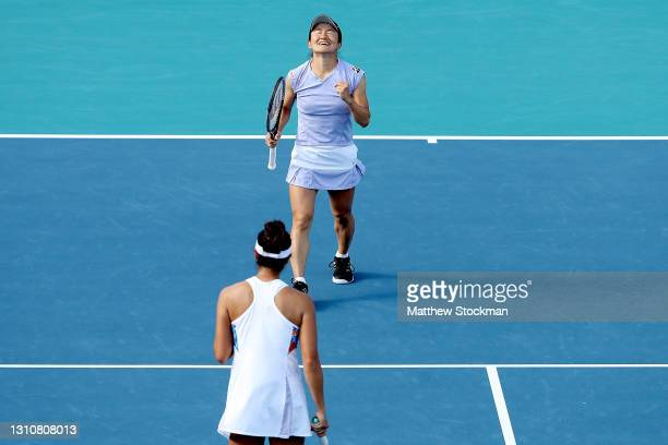 Shuko Aoyama and Ena Shibahara of Japan celebrate match point against Hayley Carter and Luisa Stefani of Brazil during the doubles final of the Miami...