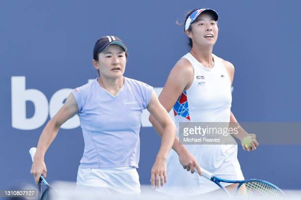 Shuko Aoyama and Ena Shibahara of Japan confer against Hayley Carter of the United States and Luisa Stefani of Brazil during the final of the Miami...