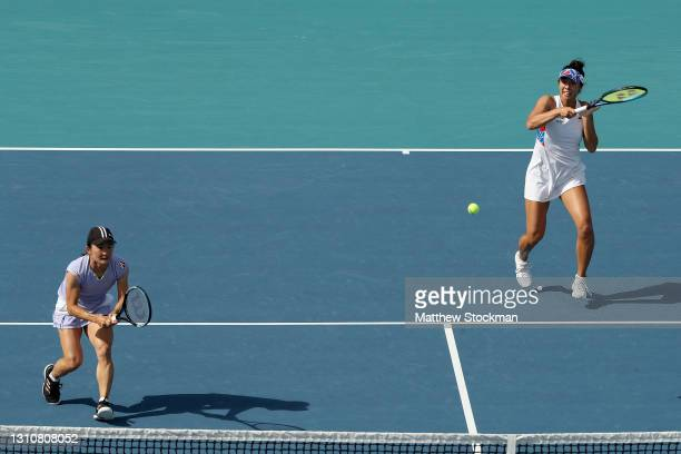 Shuko Aoyama and Ena Shibahara of Japan play Hayley Carter and Luisa Stefani of Brazil during the doubles final of the Miami Open at Hard Rock...