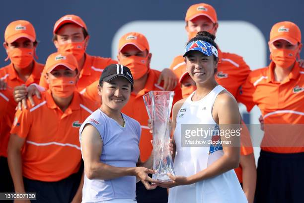 Shuko Aoyama and Ena Shibahara of Japan pose with the winner's trophy after defeating Hayley Carter and Luisa Stefani of Brazil during the doubles...