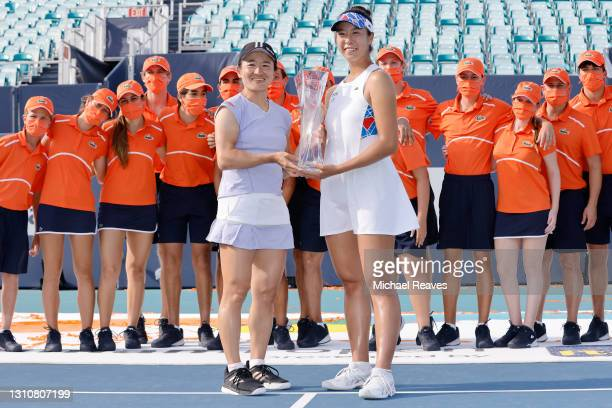Shuko Aoyama and Ena Shibahara of Japan pose with the winner's trophy after defeating Hayley Carter of the United States and Luisa Stefani of Brazil...