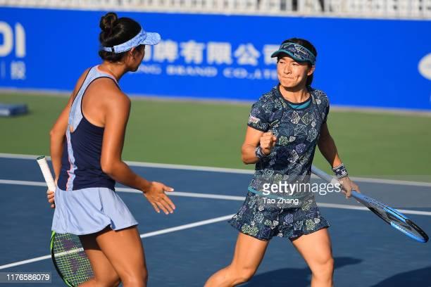 Shuko Aoyama and Ena Shibahara of Japan react during the match against Zhaoxuan Yang of China and Makoto Ninomiya of Japan on Day 2 of 2019 Dongfeng...