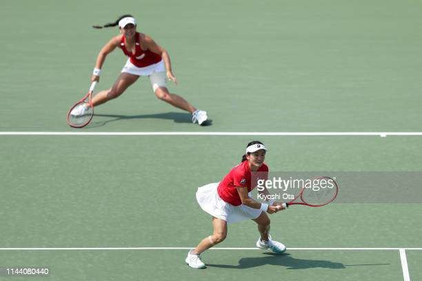 Shuko Aoyama and Eri Hozumi of Japan play in their doubles match against Lesley Kerkhove and Demi Schuurs of the Netherlands on day two of the Fed...