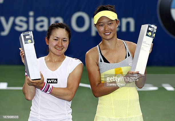 Shuko Aoyama of Japan and Kai-Chen Chang of Chinese Taipei pose with their trophies during a presentation ceremony after they defeated Janette...