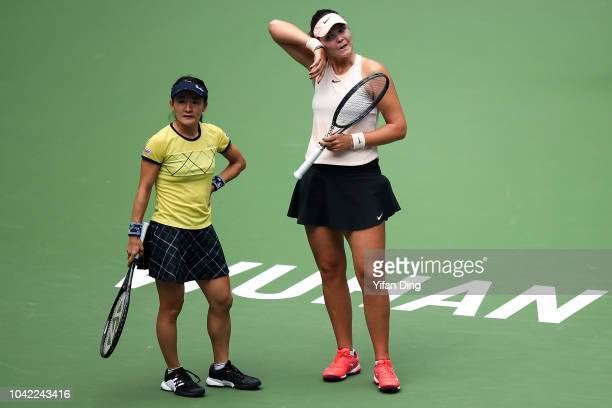 Shuko Aoyama of Japan and Lidziya Marozava of Belarus react after losing a point during their doubles semi final match against Elise Mertens of...