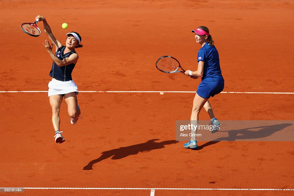 Shuko Aoyama of Japan and Renata Voracova of Czech Republic in action during their doubles final match against Kiki Bertens of Netherlands and Johanna Larsson of Sweden on day eight of the Nuernberger Versicherungscup 2016 on May 21, 2016 in Nuremberg, Germany.