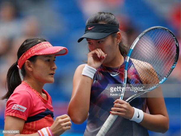 Shuko Aoyama of Japan and Zhaoxuan Yang of China in action in the Finals Double match between YungJan Chan of Chinese Taipei and Martina Hingis of...
