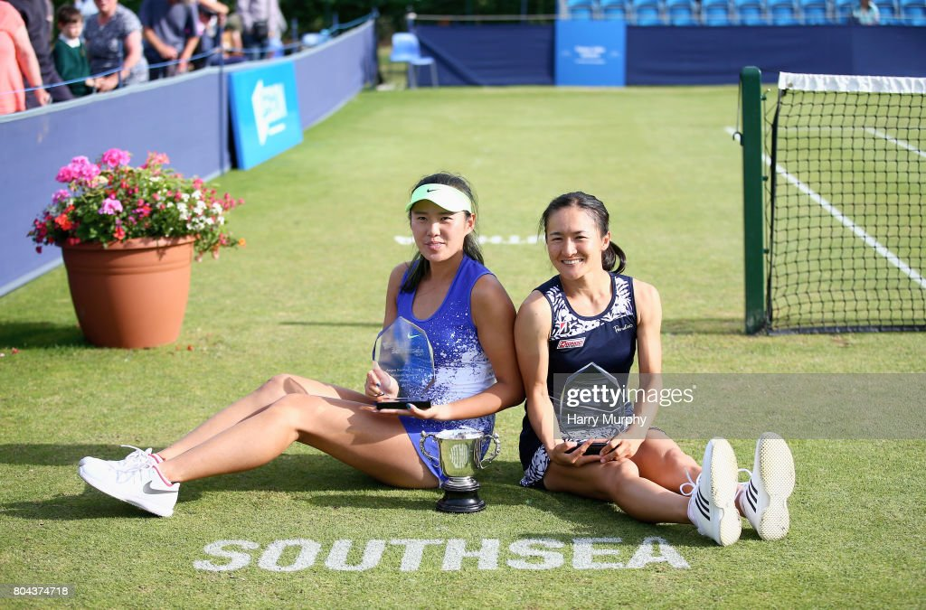 Shuko Aoyama of Japan and Zhaoxuan Yang of China pose with the trophy after the Aegon Southsea Trophy final match between Shuko Aoyama of Japan and Zhaoxuan Yang of China and Viktorija Golubic of Switzerland and Lyudmyla Kichenok of Ukraine on June 30, 2017 in Portsmouth, England.