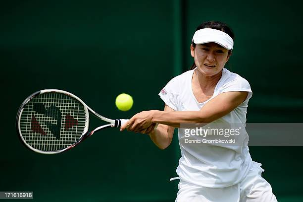 Shuko Aoyama of Japan plays a backhand during the Ladies' Doubles first round match between Anastasia Pavlyuchenkova of Russia and Lucie Safarova of...