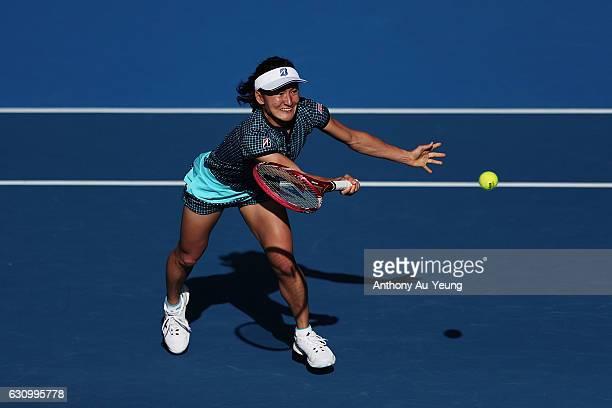 Shuko Aoyama of Japan plays a volley with Makoto Ninomiya of Japan in their doubles match against Kirsten Flipkens of Belgium and Jelena Ostapenko of...