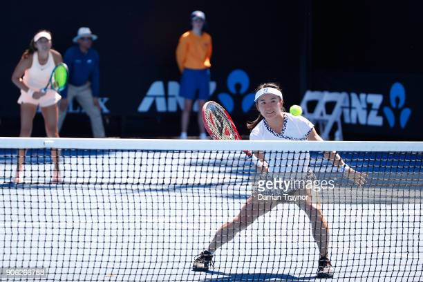 Shuko Aoyama of Japan returns serve in her first round women's doubles match with Zhaoxuan Yang of China against Taylor Townsend of the United States...