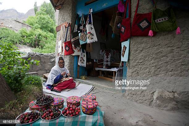 Shukrat Bibi sits as she uses needle for the traditional art of embroidery at her small shop near to Baltit Fort in the old settlement in Karimabad...