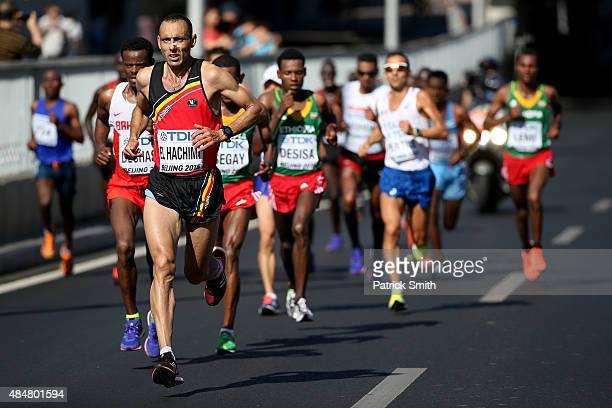 Shumi Dechasa of Bahrain and Abdelhadi El Hachimi of Belgium compete in the Men's Marathon during day one of the 15th IAAF World Athletics...
