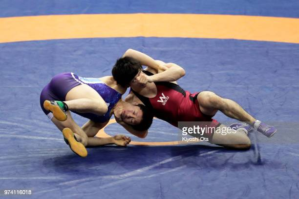Shun Ito competes against Yuta Nakamura in the Men's Freestyle 70kg second round match on day one of the All Japan Wrestling Invitational...