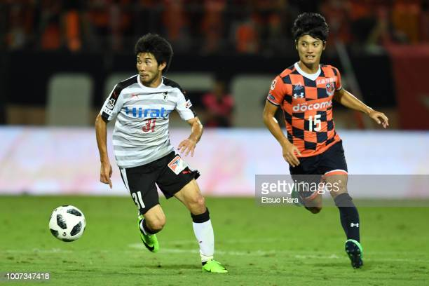 Shun Ito of Roasso Kumamoto and Keisuke Oyama of Omiya Ardija compete for the ball during the JLeague J2 match between Omiya Ardija and Roasso...