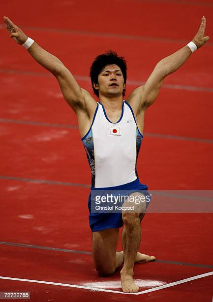 Shun Kuwahara of Japan competes in the Men's Floor final during the Artistic Gymnastics competition during the 15th Asian Games Doha 2006 at The...