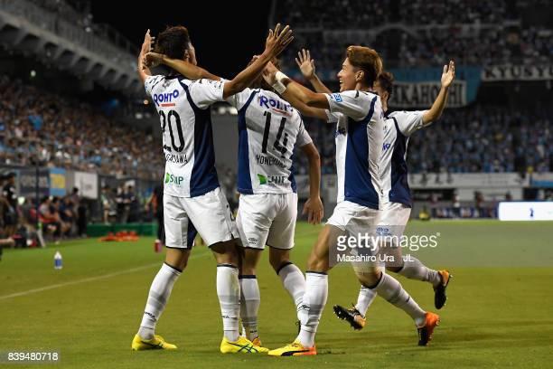Shun Nagasawa of Gamba Osaka celebrates scoring his side's second goal with his team mates during the JLeague J1 match between Sagan Tosu and Gamba...