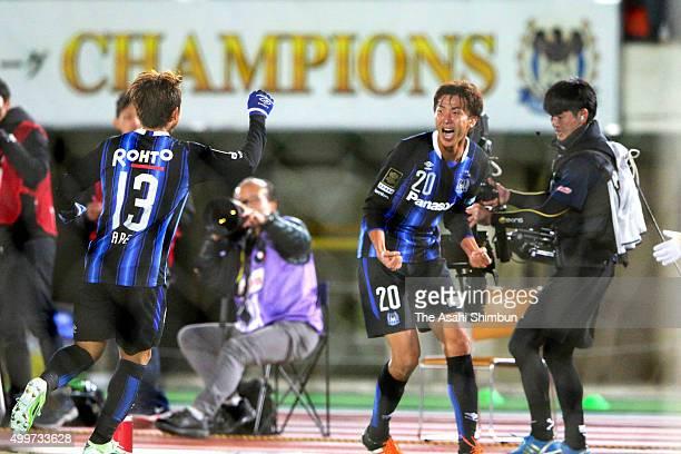 Shun Nagasawa of Gamba Osaka celebrates scoring his team's first goal during the JLeague Championship Final frist leg match between Gamba Osaka and...