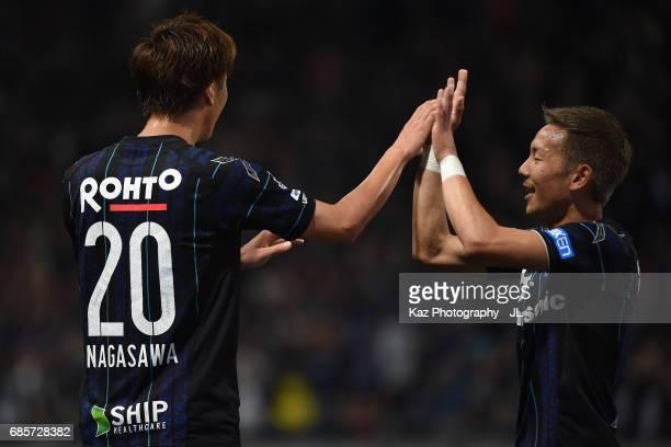 Shun Nagasawa of Gamba Osaka celebrates scoring the opening goal with his team mate Yosuke Ideguchi during the JLeague J1 match between Gamba Osaka...