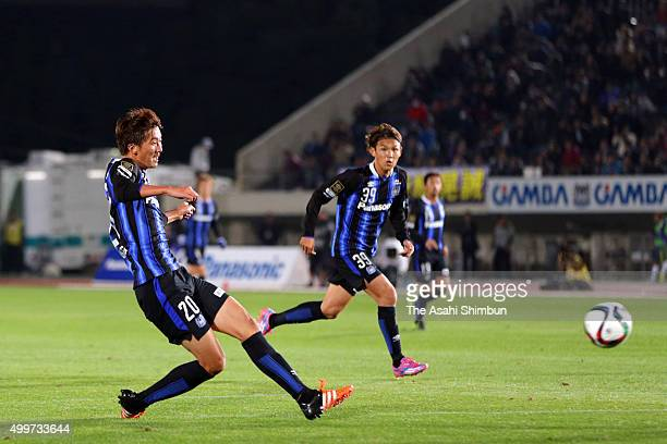 Shun Nagasawa of Gamba Osaka scores his team's first goal during the JLeague Championship Final frist leg match between Gamba Osaka and Sanfrecce...