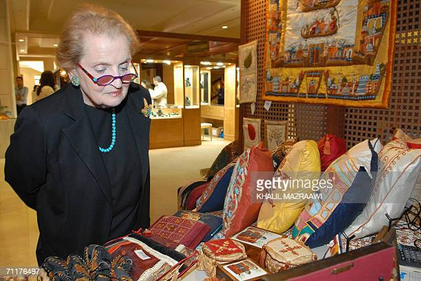 Former US State Secretary Madeleine Albright shops in the local items market or 'Souq' in a convention center after attending the Opening Ceremony of...