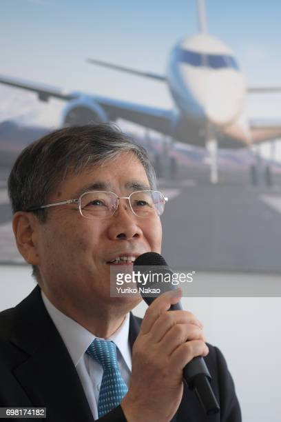Shunichi Miyanaga Mitsubishi Heavy Industries' President and Chief Executive Officer attends a news conference in front an image of the third Flight...