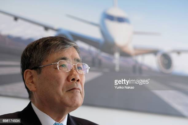Shunichi Miyanaga Mitsubishi Heavy Industries' President and Chief Executive Officer attend a news conference for their Mitsubishi Regional Jet at...