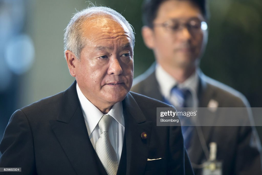 Shunichi Suzuki, newly-appointed Tokyo Olympic and Paralympic Games minister of Japan, left, arrives at the Prime Minister's official residence in Tokyo, Japan, on Thursday, Aug. 3, 2017. Japanese Prime Minister Shinzo Abe is reshuffling his ministers and party officials after a slump in popularity and a humiliating local election defeat. Photographer: Tomohiro Ohsumi/Bloomberg via Getty Images