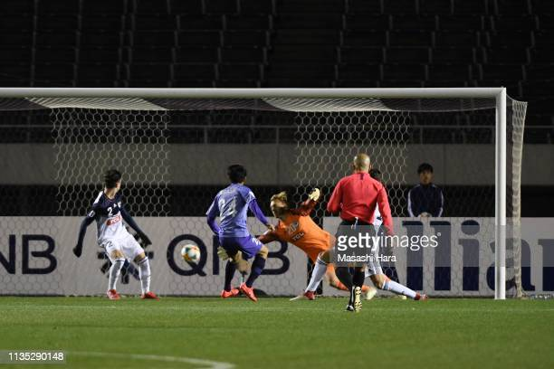 Shunki Higashi of Sanfrecce Hiroshima scores the opening goal during the AFC Champions League Group F match between Sanfrecce Hiroshima and Melbourne...