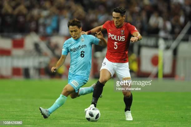 Shunki Takahashi of Vissel Kobe and Tomoaki Makino of Urawa Red Diamonds compete for the ball during the JLeague J1 match between Urawa Red Diamonds...