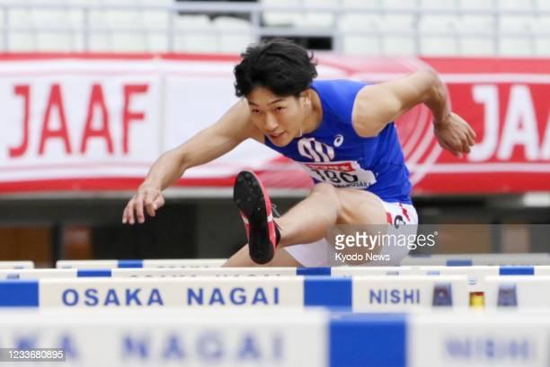 Shunsuke Izumiya competes in the final of the men's 110-meter hurdles at the national athletics championships at Yanmar Stadium Nagai in Osaka,...