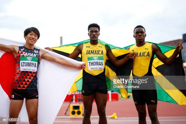 Shunsuke Izumiya of Japan Damion Thomas of Jamaica and Orlando Bennett of Jamaica celebrate after winning medals in the final of the men's 110m...
