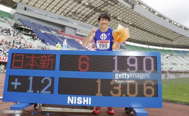 Shunsuke Izumiya poses for a photo after setting a national record in the men's 110-meter hurdles and qualifying for the Tokyo Olympics at the...