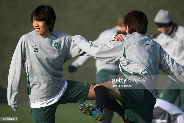 Shunsuke Nakamura and Koki Mizuno warm up during a Celtic training session ahead of their UEFA Champions league match against Barcelona February 19...