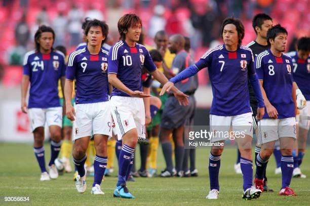 Shunsuke Nakamura and Yasuhito Endo and Shinji Okazaki and Daisuke Matsui of Japan look on after the international friendly match between South...