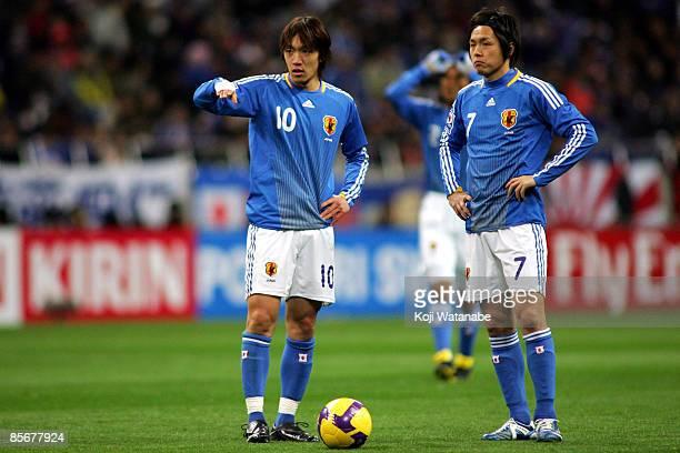 Shunsuke Nakamura and Yasuhito Endo of Japan look on during the 2010 FIFA World Cup Asian qualifier match between Japan and Bahrain at Saitama...
