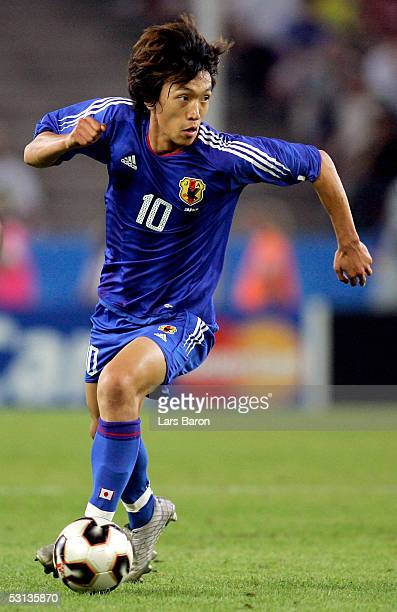 Shunsuke Nakamura from Japan runs with the ball during the match between Japan and Brazil for the Confederations Cup 2005 on June 22 2005 at the...