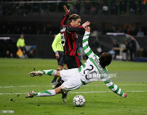 Shunsuke Nakamura of Celtic goes to ground and has a strong claim for a penalty after a challenge by Massimo Ambrosini of Milan during the UEFA...