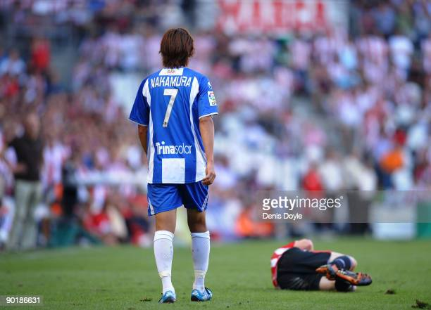 Shunsuke Nakamura of Espanyol concerns himself about the condition of Iker Muniain of Athletic Bilbao after he made a foul on Muniain during the La...