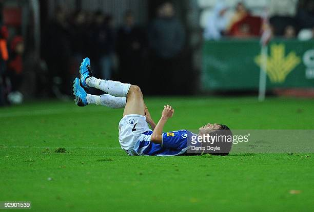 Shunsuke Nakamura of Espanyol falls after being tackled by Diego Castro of Sporting Gijon during the La Liga match between Espanyol and Sporting...